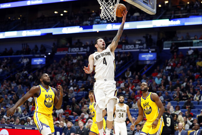 New Orleans Pelicans guard JJ Redick (4) shoots over Golden State Warriors forward Eric Paschall (7) in the second half of an NBA basketball game in New Orleans, Sunday, Nov. 17, 2019. The Pelicans won 108-100. (AP Photo/Tyler Kaufman)