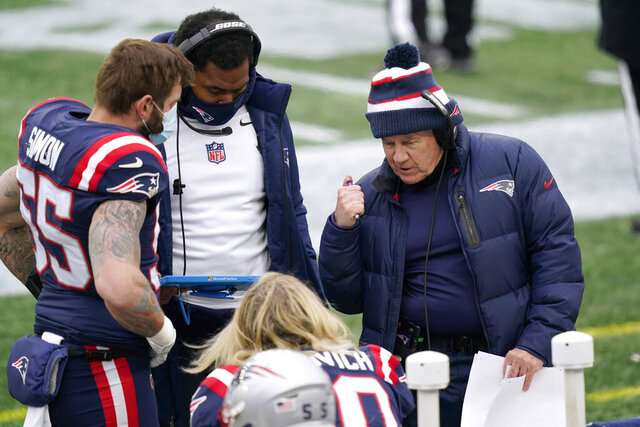 New England Patriots head coach Bill Belichick, right, instructs defensive lineman Chase Winovich, center, as inside linebackers coach Jerod Mayo, second from left, instructs defensive end John Simon, left, on the sideline in the first half of an NFL football game against the New York Jets, Sunday, Jan. 3, 2021, in Foxborough, Mass. (AP Photo/Elise Amendola)