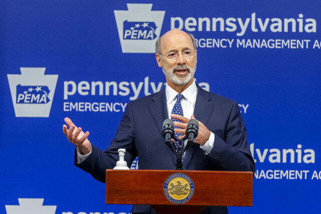 "FILE - In this May 29, 2020, file photo, Pennsylvania Gov. Tom Wolf meets with the media at The Pennsylvania Emergency Management Agency (PEMA) headquarters in Harrisburg, Pa. A federal judge on Monday, Sept. 14 struck down Gov. Tom Wolf's pandemic restrictions that required people to stay at home, placed size limits on gatherings and ordered ""non-life-sustaining"" businesses to shut down, calling them unconstitutional. (Joe Hermitt/The Patriot-News via AP, File)"