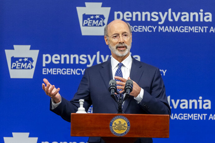 """FILE - In this May 29, 2020, file photo, Pennsylvania Gov. Tom Wolf meets with the media at The Pennsylvania Emergency Management Agency (PEMA) headquarters in Harrisburg, Pa. A federal judge on Monday, Sept. 14 struck down Gov. Tom Wolf's pandemic restrictions that required people to stay at home, placed size limits on gatherings and ordered """"non-life-sustaining"""" businesses to shut down, calling them unconstitutional. (Joe Hermitt/The Patriot-News via AP, File)"""