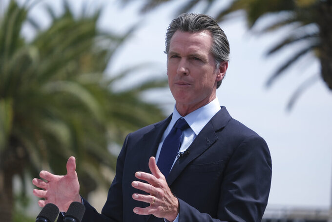 FILE - In this June 15, 2021, file photo California Gov. Gavin Newsom talks during a news conference at Universal Studios in Universal City, Calif. Newsom will face more than three dozen people who have filed the required paperwork to run in the Sept. 14 recall election that could remove him from office. (AP Photo/Ringo H.W. Chiu, File)