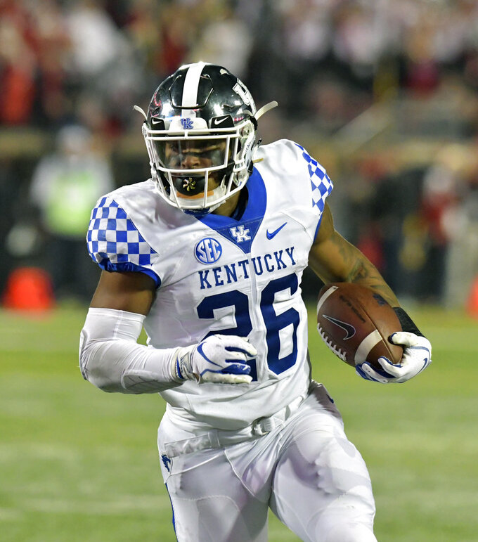 Kentucky running back Benny Snell Jr. heads upfield during the first half of the team's NCAA college football game against Louisville in Louisville, Ky., Saturday, Nov. 24, 2018. (AP Photo/Timothy D. Easley)