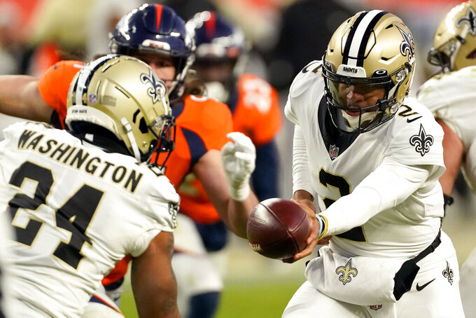 New Orleans Saints quarterback Jameis Winston (2) hands off to running back Dwayne Washington (24) during the second half of an NFL football game against the Denver Broncos, Sunday, Nov. 29, 2020, in Denver. (AP Photo/Jack Dempsey)
