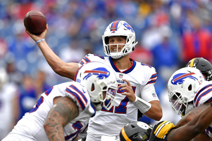Buffalo Bills quarterback Josh Allen (17) throws a pass during the second half of an NFL football game against the Pittsburgh Steelers in Orchard Park, N.Y., Sunday, Sept. 12, 2021. The Steelers won 23-16. (AP Photo/Adrian Kraus)