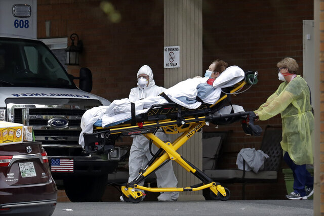 A resident is removed from the Gallatin Center for Rehabilitation and Healing Monday, March 30, 2020, in Gallatin, Tenn. Multiple people tested positive for the coronavirus at the facility Friday. Tennessee Gov. Bill Lee issued a statewide