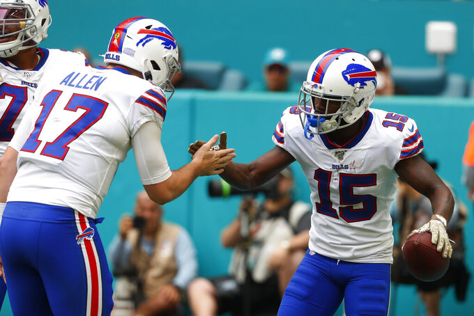 Buffalo Bills quarterback Josh Allen (17) congratulates wide receiver John Brown (15) after Brown scores a touchdown, during the first half at an NFL football game against the Miami Dolphins, Sunday, Nov. 17, 2019, in Miami Gardens, Fla. (AP Photo/Wilfredo Lee)