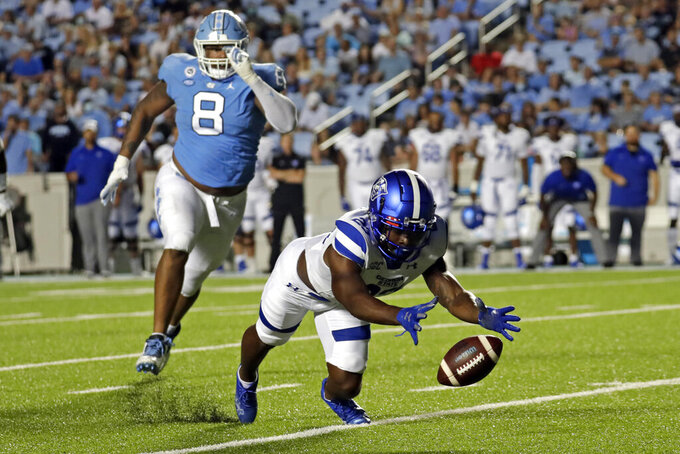 Georgia State running back Marcus Carroll (23) scrambles to recover a fumble ahead of North Carolina defensive lineman Myles Murphy (8) during the first half of an NCAA college football game in Chapel Hill, N.C., Saturday, Sept. 11, 2021. (AP Photo/Chris Seward)