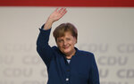 German Chancellor Angela Merkel waves after her speech at the party convention of the Christian Democratic Party CDU in Hamburg, Germany, Friday, Dec. 7, 2018. 1001 delegates are electing a successor of German Chancellor Angela Merkel who doesn't run again for party chairmanship after more than 18 years at the helm of the party. (AP Photo/Markus Schreiber)