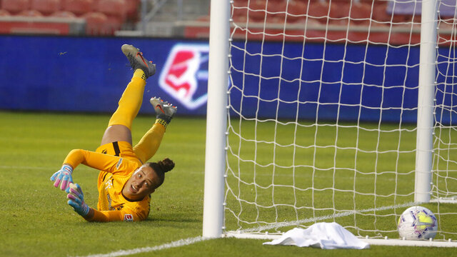 Sky Blue goalkeeper Kailen Sheridan is scored upon by the Chicago Red Stars in the first half of an NWSL Challenge Cup soccer semifinal match Wednesday, July 22, 2020, in Sandy, Utah. (AP Photo/Rick Bowmer)