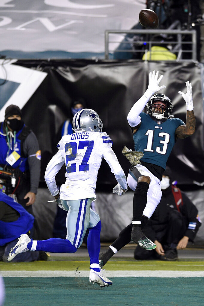 Philadelphia Eagles' Travis Fulgham (13) catches a touchdown pass against Dallas Cowboys' Trevon Diggs (27) during the second half of an NFL football game, Sunday, Nov. 1, 2020, in Philadelphia. (AP Photo/Derik Hamilton)