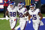 New York Giants' Wayne Gallman, center, celebrates his touchdown with Evan Engram, left, and Golden Tate during the first half of an NFL football game against the Tampa Bay Buccaneers, Monday, Nov. 2, 2020, in East Rutherford, N.J. (AP Photo/Corey Sipkin)