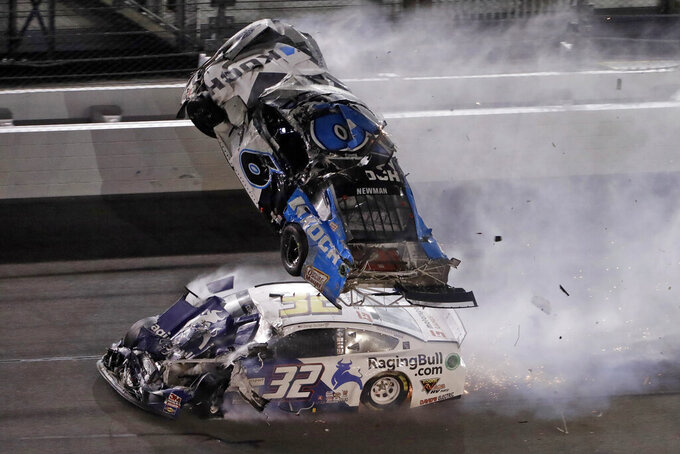 FILE - IN this Feb. 17, 2020 file photo, Ryan Newman (6) goes airborne after crashing with Corey LaJoie (32) during the NASCAR Daytona 500 auto race at Daytona International Speedway in Daytona Beach, Fla.   NASCAR's return to racing next shifts to Talladega Superspeedway in Alabama, with a new rules package altered after Ryan Newman's frightful crash in the season-opening Daytona 500.  The facility will admit up to 5,000 fans — at the same time at least one NASCAR team is facing a coronavirus scare — while NASCAR will be on the lookout for the newly-banned Confederate flag. (AP Photo/Chris O'Meara, File)