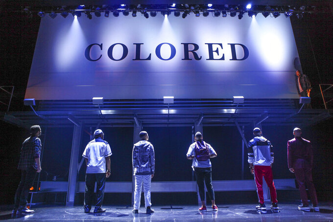 """This image released by O+M/DKC shows a scene from the production of  Keenan Scott II's play """"Thoughts of a Colored Man,"""" a work about the outer and inner lives of Black men. The play will be produced on Broadway when the new season starts. (Michael Davis/O+M/DKC via AP)"""