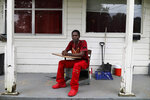 FILE - In this Saturday, June 8, 2019, file photo, Joshua Love sits on his front porch in his