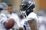 Seattle Seahawks safety Jamal Adams tosses a football during NFL football practice, Tuesday, Aug. 17, 2021, in Renton, Wash. The Seahawks signed Adams to a four-year contract extension Tuesday that is expected to make the former All-Pro the highest-paid safety in the NFL. (AP Photo/Ted S. Warren)