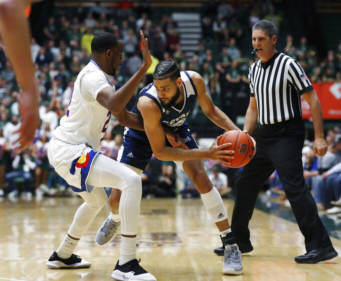 Colorado State guard J.D. Paige, left, defends against Nevada forward Caleb Martin during the first half of an NCAA college basketball game Wednesday, Feb. 6, 2019, in Fort Collins, Colo. (AP Photo/David Zalubowski)