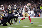 San Francisco 49ers running back Raheem Mostert (31) carries for a touchdown in the first half an NFL football game against the New Orleans Saints in New Orleans, Sunday, Dec. 8, 2019. (AP Photo/Brett Duke)