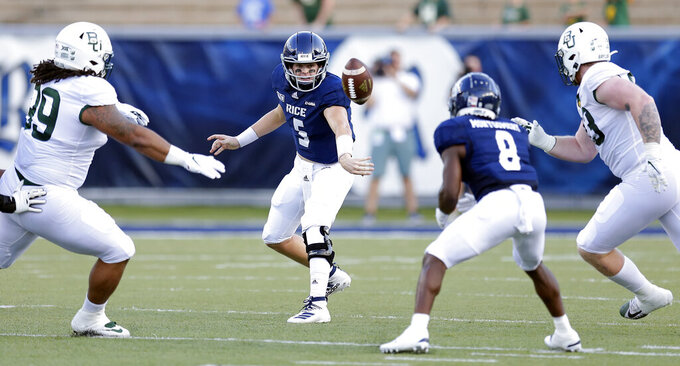 Rice quarterback Wiley Green (5) pitches out to wide receiver Cameron Montgomery (8) as Baylor defensive tackles Bravvion Roy, left, and defensive tackle James Lynch close in during the first half of an NCAA college football game Saturday, Sept. 21, 2019, in Houston. (AP Photo/Michael Wyke)