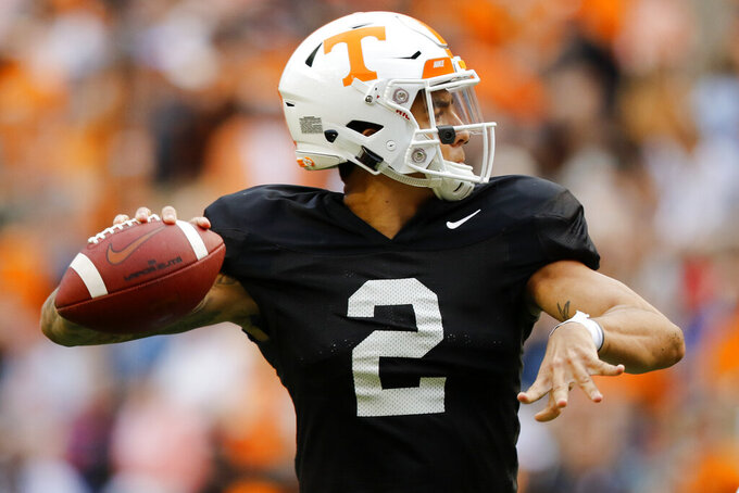 Tennessee quarterback Jarrett Guarantano (2) looks to pass during the Orange and White NCAA college spring football game Saturday, April 13, 2019, in Knoxville, Tenn. (C.B. Schmelter/Chattanooga Times Free Press via AP)