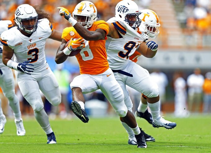 Tennessee running back Ty Chandler (8) runs for yardage as he's chased by UTEP linebacker Sione Tupou (3) in the second half of an NCAA college football game Saturday, Sept. 15, 2018, in Knoxville, Tenn. (AP Photo/Wade Payne)