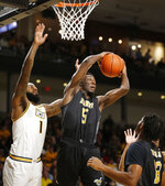 Alabama State's Tobi Ewueshe (5) pulls in a rebound against Virginia Commonwealth's Mike'L Simms during an NCAA college basketball game in Richmond, Va., Monday, Nov. 25, 2019. (James H. Wallace/Richmond Times-Dispatch via AP)