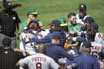 Oakland Athletics and Texas Rangers benches clear after Athletics' Ramon Laureano charged the dugout after being hit by a pitch thrown by Astros' Humberto Castellanos during the seventh inning of a baseball game Sunday, Aug. 9, 2020, in Oakland, Calif. (AP Photo/Ben Margot)