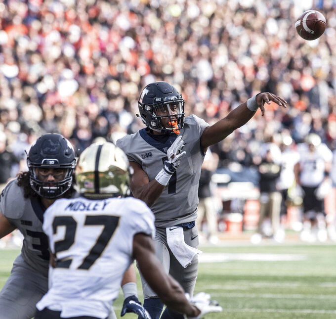 Illinois quarterback AJ Bush, Jr (1) throws in the first half of an NCAA college football game against Purdue, Saturday, Oct. 13, 2018, in Champaign, Ill. (AP Photo/Holly Hart)