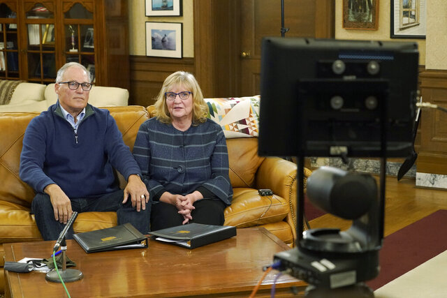 Washington Gov. Jay Inslee and his wife, Trudi, rehearse in the governor's office as they prepare to make a statewide televised address on COVID-19, which health officials have warned is accelerating rapidly throughout the state, Thursday, Nov. 12, 2020, at the Capitol in Olympia, Wash. (AP Photo/Ted S. Warren)