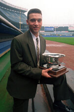 FILE - In this Sept. 14, 1994, file photo, New York Yankees prospect Derek Jeter poses on the dugout steps at Yankee Stadium in New York, where he was named Baseball America's minor league player of the year.  Jeter could be a unanimous pick when Baseball Hall of Fame voting is announced Tuesday, Jan. 21, 2020. (AP Photo/Mark Lennihan)