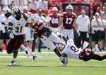 Nebraska running back Greg Bell (25) is tackled by Troy cornerback Marcus Jones (8) and linebacker A.J. Smiley (31) during the first half of an NCAA college football game in Lincoln, Neb., Saturday, Sept. 15, 2018. (AP Photo/Nati Harnik)