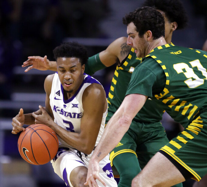 Kansas State guard Kamau Stokes (3) controls the ball while covered by George Mason forward Jarred Reuter (31) during the first half of an NCAA college basketball game in Manhattan, Kan., Saturday, Dec. 29, 2018. (AP Photo/Orlin Wagner)