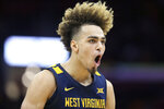 West Virginia's Emmitt Matthews Jr. celebrates during the second half of an NCAA college basketball game against Ohio State Sunday, Dec. 29, 2019, in Cleveland. West Virginia defeated Ohio State 67-59. (AP Photo/Ron Schwane)