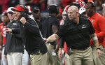 Georgia head coach Kirby Smart speaks to players against Alabama during the first half of the Southeastern Conference championship NCAA college football game, Saturday, Dec. 1, 2018, in Atlanta. (AP Photo/John Amis)