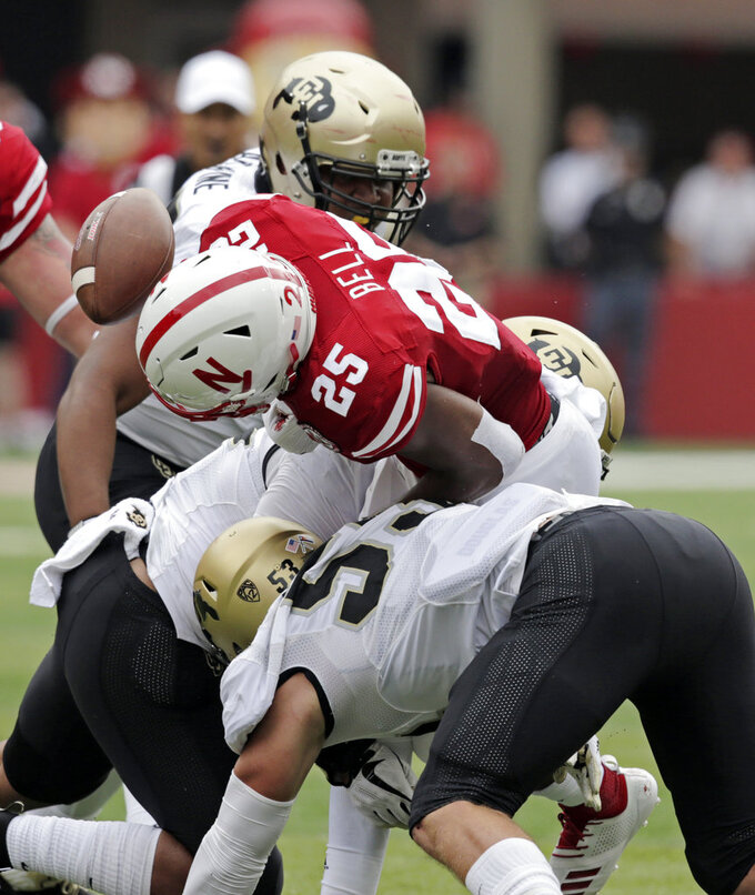 Nebraska running back Greg Bell (25) fumbles the ball for a turnover against Colorado linebacker Nate Landman (53), defensive lineman Israel Antwine, rear, and linebacker Rick Gamboa (32) during the first half of an NCAA college football game in Lincoln, Neb., Saturday, Sept. 8, 2018. (AP Photo/Nati Harnik)