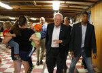 FILE - In this Sept. 3, 2019, file photo, Democratic presidential candidate Sen. Bernie Sanders, I-Vt., waves to potential supporters as he leaves a campaign event at the Circle 9 Ranch Campground Bingo Hall in Epsom, N.H.  Sanders successfully turned his outsider credentials and call for political revolution into a commanding victory in the 2016 New Hampshire primary. But as he seeks a repeat performance, the Vermont senator could face unlikely competition. (AP Photo/Mary Schwalm, File)