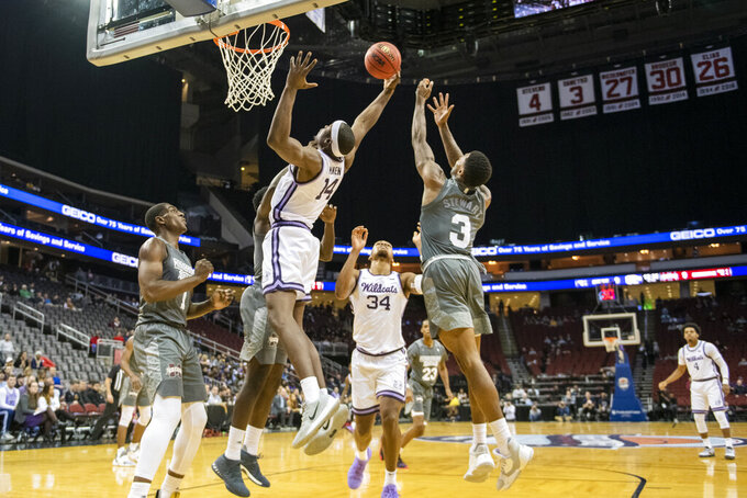 Mississippi State forward Reggie Perry (1) and guard D.J. Stewart Jr. (3) vie for a rebound with Kansas State forward Makol Mawien (14) during the first half of the Never Forget Tribute Classic NCAA college basketball game, Saturday, Dec. 14, 2019, in Newark, N.J. (AP Photo/Corey Sipkin)