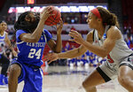 Kentucky's Taylor Murray (24) grabs the ball while North Carolina State's Kai Crutchfield (3) defends during the first half of a second round women's college basketball game in the NCAA Tournament in Raleigh, N.C., Monday, March 25, 2019. (AP Photo/Gerry Broome)