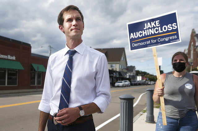 In this Sept. 1, 2020, photo, Democrat Jake Auchincloss, candidate for the 4th Congressional District in Massachusetts, greets supporters in Needham, Mass. Auchincloss was elected in the Nov. 3 general election, filling the seat held by U.S. Rep. Joe Kennedy III, who did not seek reelection but mounted an unsuccessful bid for a Senate seat. (Nancy Lane/The Boston Herald via AP)