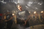 New York Yankees' Aaron Judge celebrates after the Yankees defeated the Los Angeles Angels and clinched the AL East baseball title Thursday, Sept. 19, 2019, in New York. (AP Photo/Mary Altaffer)