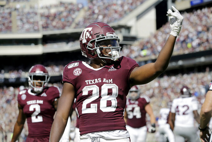 Texas A&M running back Isaiah Spiller (28) reacts after scoring a touchdown against Mississippi State during the second half of an NCAA college football game, Saturday, Oct. 26, 2019, in College Station, Texas. (AP Photo/Sam Craft)