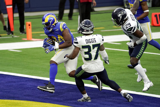 Los Angeles Rams running back Malcolm Brown, left, scores against the Seattle Seahawks during the first half of an NFL football game Sunday, Nov. 15, 2020, in Inglewood, Calif. (AP Photo/Jae C. Hong )108