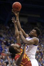 Kansas center Udoka Azubuike (35) shoots over Iowa State forward Solomon Young (33) during the first half of an NCAA college basketball game in Lawrence, Kan., Monday, Feb. 17, 2020. (AP Photo/Orlin Wagner)