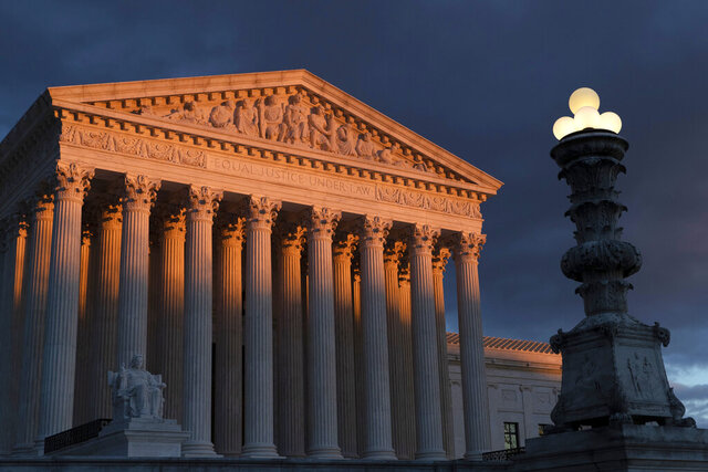"""FILE - In this Jan. 24, 2019 file photo, the Supreme Court is seen at sunset in Washington. The Supreme Court has ruled that insurance companies can collect $12 billion from the federal government to cover their losses in the early years of the health care law championed by President Barack Obama. The justices voted 8-1 Monday in holding that insurers are entitled to the money under a provision of the """"Obamacare"""" health law that promised the companies a financial cushion for losses they might incur by selling coverage to people in the marketplaces created by the health care law. (AP Photo/J. Scott Applewhite)"""