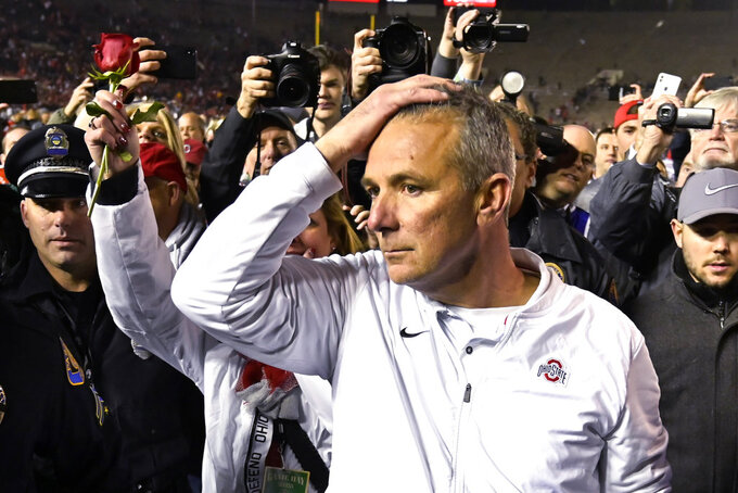Ohio State coach Urban Meyer leaves the field after Ohio State defeated Washington 28-23 in the Rose Bowl NCAA college football game Tuesday, Jan. 1, 2019, in Pasadena, Calif. (AP Photo/Mark J. Terrill)