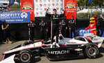 FILE - In this Sunday, March 10, 2019, file photo, Team Penske driver Josef Newgarden (2) of United States celebrates after winning the IndyCar Grand Prix auto race in St. Petersburg, Fla. The US-based series runs the first IndyCar Classic in Austin, Texas this week. Team Penske's Josef Newgarden will be looking for a second consecutive win after taking the season-opening race in St. Petersburg. (AP Photo/Jason Behnken, File)