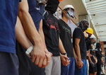 Students from Hong Kong University chains their hands outside schools in Hong Kong, Monday, Sept. 9, 2019. The silent protest comes as the Hong Kong government condemned the