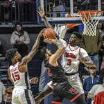 Mississippi's Luis Rodriguez (15) blocks a shot by Arkansas State's Canberk Kus (12) as Mississippi's Khadim Sy (3) also defends during the first half of an NCAA college basketball game, Friday, Nov. 8, 2019 in Oxford, Miss. (Bruce Newman/The Oxford Eagle via AP)