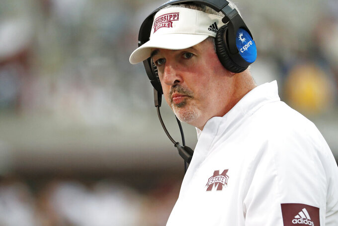 FILE - In this Oct. 19, 2019, file photo, Mississippi State head coach Joe Moorhead looks down field during the second half of an NCAA college football game against LSU, in Starkville, Miss. Two people with knowledge of the situation say Mississippi State has fired coach Joe Moorhead after just two seasons. They spoke to The Associated Press on condition of anonymity because an announcement had not yet been made by the school. A meeting was scheduled Friday, Jan. 3, 2020, with Moorhead and athletic director John Cohen. (AP Photo/Rogelio V. Solis, File)