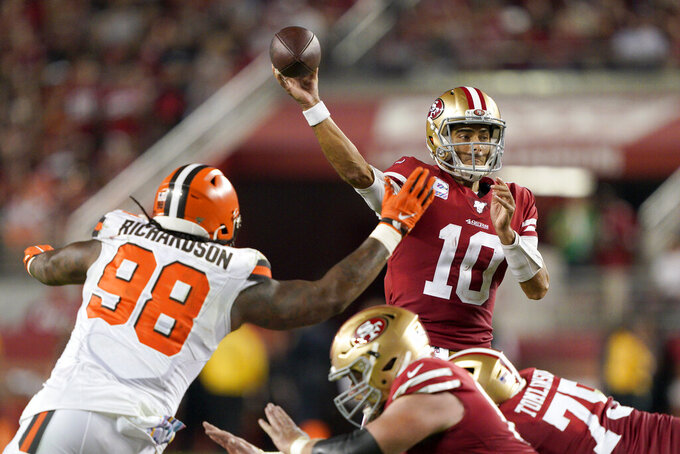 San Francisco 49ers quarterback Jimmy Garoppolo (10) passes as Cleveland Browns defensive tackle Sheldon Richardson (98) applies pressure during the second half of an NFL football game in Santa Clara, Calif., Monday, Oct. 7, 2019. (AP Photo/Tony Avelar)