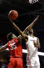 Temple's Quinton Rose, right, goes up for a shot against Houston's Fabian White Jr. during the second half of an NCAA college basketball game, Wednesday, Jan. 9, 2019, in Philadelphia. Temple won 73-69. (AP Photo/Matt Slocum)